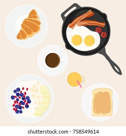 vector image of set of dishes for a traditional Breakfast - frying pan with bacon and eggs, toast with peanut butter, oatmeal with berries and fruit, juice, coffee, croissant. Top view.