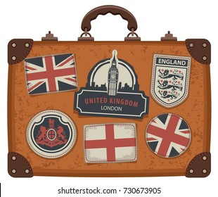 Vector image of travel suitcase with patches set with British and English symbols, coats of arms and flags of the United Kingdom and England in retro style