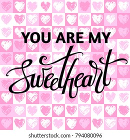 A vector image for valentine's day with sweetheart lettering. Calligraphy for design. You are my sweetheart. Hearts patttern background.