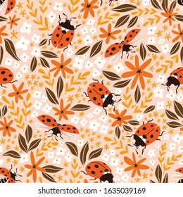 Vector insect seamless pattern. Hand-drawn ladybugs and flowers on the pink background. Summer ditzy floral pattern.