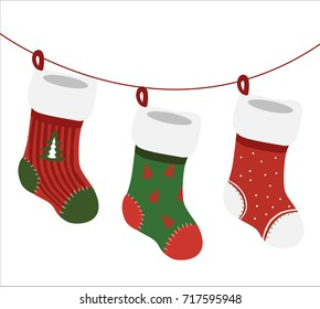 A vector isolated on white background - three empty decorated christmas socks in christmas colors hanging on cord.