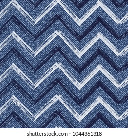 Vector Jeans background with Chevron Zigzag Paint Brush Strokes. Denim seamless pattern. Blue jeans cloth