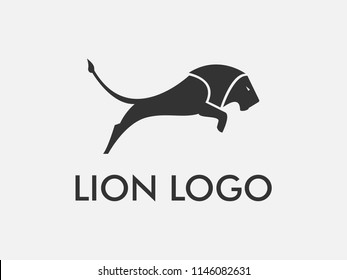 Vector of leaping lion logo design with abstract full body