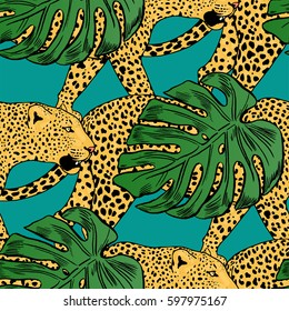 vector leopards in colorful tropical flowers seamless background.