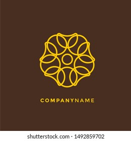 Vector logo design template and emblem made with leaves and flowers - luxury beauty spa concept - badge for yoga studios, holistic medicine centers, natural and organic food products and packaging.