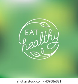 Vector logo design template in trendy linear style with hand-lettering - eat healthy - vegetarian and organic food badge or emblem for food packaging - label with leaves on green background