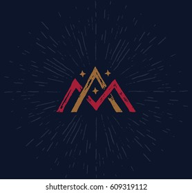 Vector logo - monogram in a worn vintage style. The interwoven letters A and M forming the symbol of the mountain