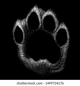 The Vector logo paw for T-shirt design or outwear. on the black fabric or canvas.