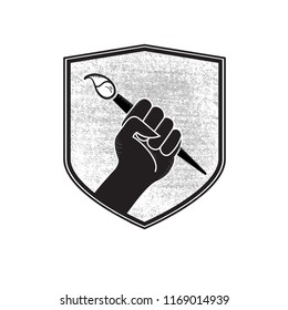 Vector Make Art Not War Artist Fist in Military Badge Holding Paint Brush in Black and White with textured patch background.