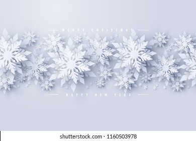 Vector Merry Christmas and Happy New Year background with realistic looking paper cut snowflakes. Seasonal Christmas and New Year holidays greeting card