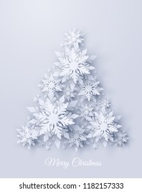 Vector Merry Christmas and Happy New Year greeting card design with Christmas tree made of realistic looking paper cut snowflakes. Seasonal Xmas holidays paper craft background