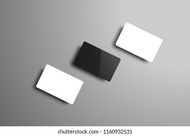 vector mockup of three bank or gift cards lying on a diagonal. Realistic black and white templates on a gray background.