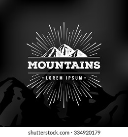 Vector mountains emblem. Outdoor activity symbol.