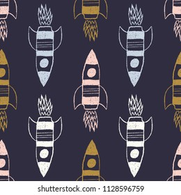 vector multi color rockets on a dark blue background. Seamless space pattern for kids