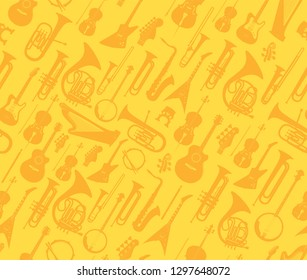 Vector musical instruments on golden seamless pattern for wrapper, web site design or banners.