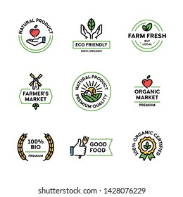 Vector natural product icon label set. Linear premium quality logo badges with green leaves. 100 percent organic certified. Farm fresh, eco friendly. Bio food emblems for healthy goods, farmers market