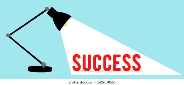 Vector of an office desktop lamp shinning on a word success