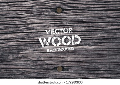Vector old dry gray wood background with two rusty nails
