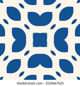 Vector ornamental seamless pattern. Indigo blue tile in traditional mediterranean, spanish, portuguese style. Abstract blue and white mosaic background texture with floral shapes, petals, leaves