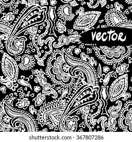 Vector paisley elements floral on a black background. Vector primitive paisley patterns seamless. Hand drawn vector floral