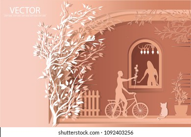 vector paper cut man riding bicycle and give flower to woman on house background