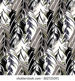 Vector pattern inspired by tropical birds and nature, parrots wings, leaves. Seamless feather texture hand drawn in dark neutral colors with lines and stripes. Bold print for winter fall fashion