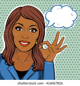 Vector pop art comic african american businesswoman showing ok hand sign with thought balloon.