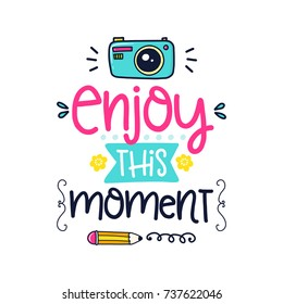 Vector poster with phrase, camera, pencil and decor elements. Typography card, color image. Enjoy this moment. Design for t-shirt and prints.