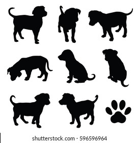 Vector puppy silhouettes with paw symbol.