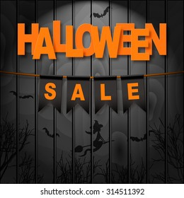 Vector realistic banner with black party flags on dark wooden background. HALLOWEEN SALE. Easy to edit.