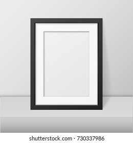 Vector realistic blank black picture frame closeup standing on white table. Design template, mockup. Stock vector illustration, eps10