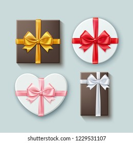 Vector realistic set of gift boxes different forms with satin ribbons and bow-knots isolated on background, top view