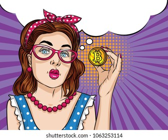 Vector retro illustration pop art comic style of a beautiful woman in eyeglasses hold a bitcoin. A Vintage poster of a girl with bitcoin in her hand over halftone dot background