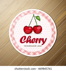 Vector round label, cherry  jam on a wooden background