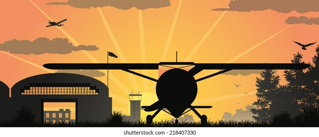 Vector scene with an airfield at the sunset.