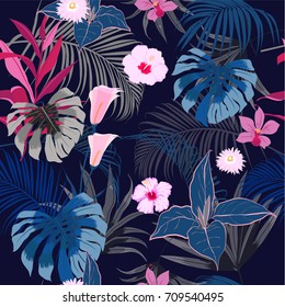 vector seamless beautiful artistic dark tropical pattern with exotic forest. Colorful original stylish floral background print, bright rainbow flower on navy blue.