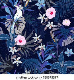 Vector seamless beautiful artistic summer dark tropical pattern with exotic forest. Bright and Colorful original stylish floral background print, bright forest flower on navy blue background.