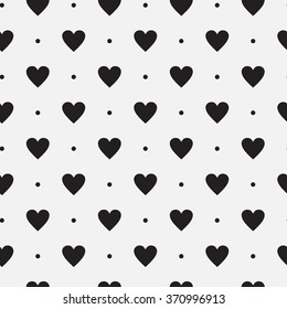 Vector seamless black and white pattern of dots and hearts.