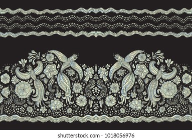 Vector seamless border in ethnic style. Exotic flying peacock birds, light pearl colored folk ornaments on a black background. Embroidery edge, wallpaper fringe, textile print, wrapping paper