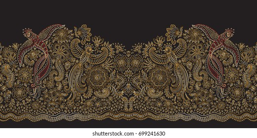 Vector seamless border in ethnic style. Exotic flying birds, golden contour thin line drawing with folk ornaments on a black background. Embroidery silhouette, wallpaper, textile print, wrapping paper