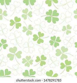 Vector seamless clover pattern. Clover pattern for Saint Patrick's Day. Clover pattern with three and four leaf. Chaotic shamrocks pattern.