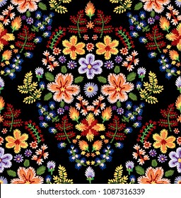 Vector seamless embroidery pattern, decorative textile ornament, pillow or bandana decor. Bohemian handmade style background design.