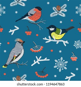 Vector seamless embroidery set of birds, berries and snowflakes illustrations for christmas or New Year decoration design.