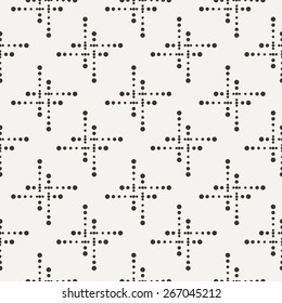 Vector seamless geometric pattern of dots of different sizes in two colors