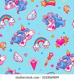 Vector seamless hand drawn pattern with cute adorable unicorns, clouds, rainbow and stars in cartoon style on blue. Magic childish background with little unicorns.