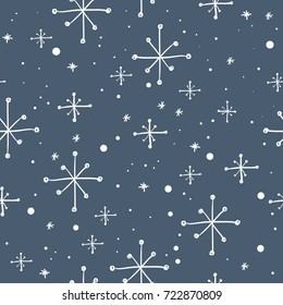Vector seamless hand drawn snowflakes pattern. Winter background.