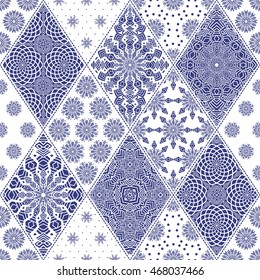 Vector seamless patchwork pattern from indigo blue and white oriental ornaments, rhombus rosette, stylized flower, star, snowflake. Geometrical  textile print,  pillow embroidery. Art deco wallpaper