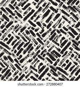 Vector seamless pattern. Abstract background with brush strokes. Monochrome hand drawn texture. Randomly disposed sloppy strokes. Hipster graphic design.