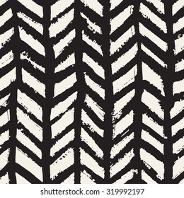 Vector seamless pattern. Abstract background with brush strokes. Monochrome hand drawn texture with herringbone. Trendy hipster print.