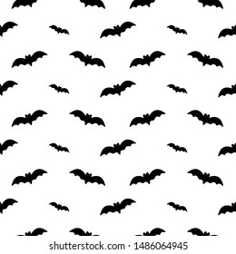 Vector seamless pattern background with bats silhouettes for international bat night or halloween design.